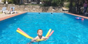 Child in swimming pool at Almond Hill House, Andalucia, Spain